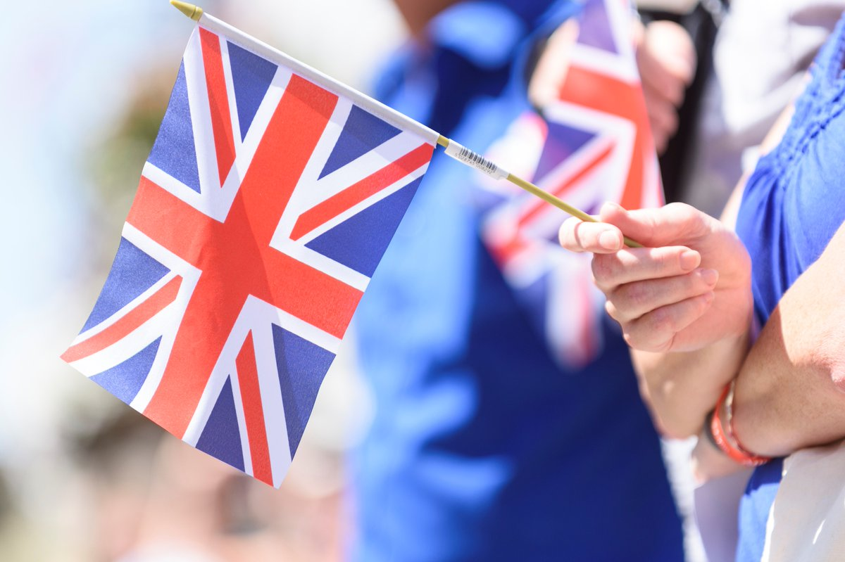 Small union jack flag in hand image