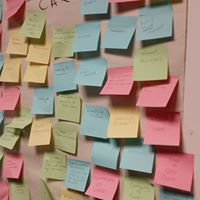 Post it notes from MVP meeting, blue, yellow, green, pink